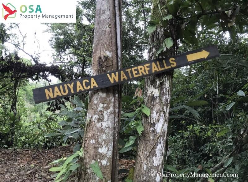 nauyaca waterfall trail sign tilted